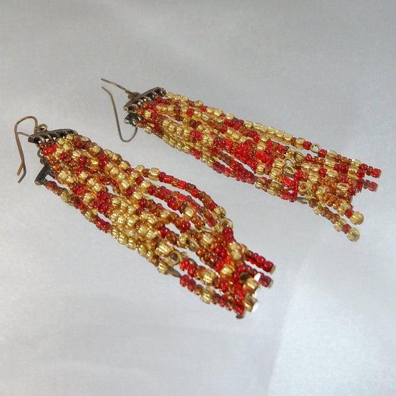 #Vintage Earrings. Shoulder Sweeper Earrings. Red Gold Glass Bugle Beads. Dangling Pierced. waalaa. #antique #shopping #jewelry #jewellery #gifts #wedding #etsy https://t.co/ieN6M95QOA