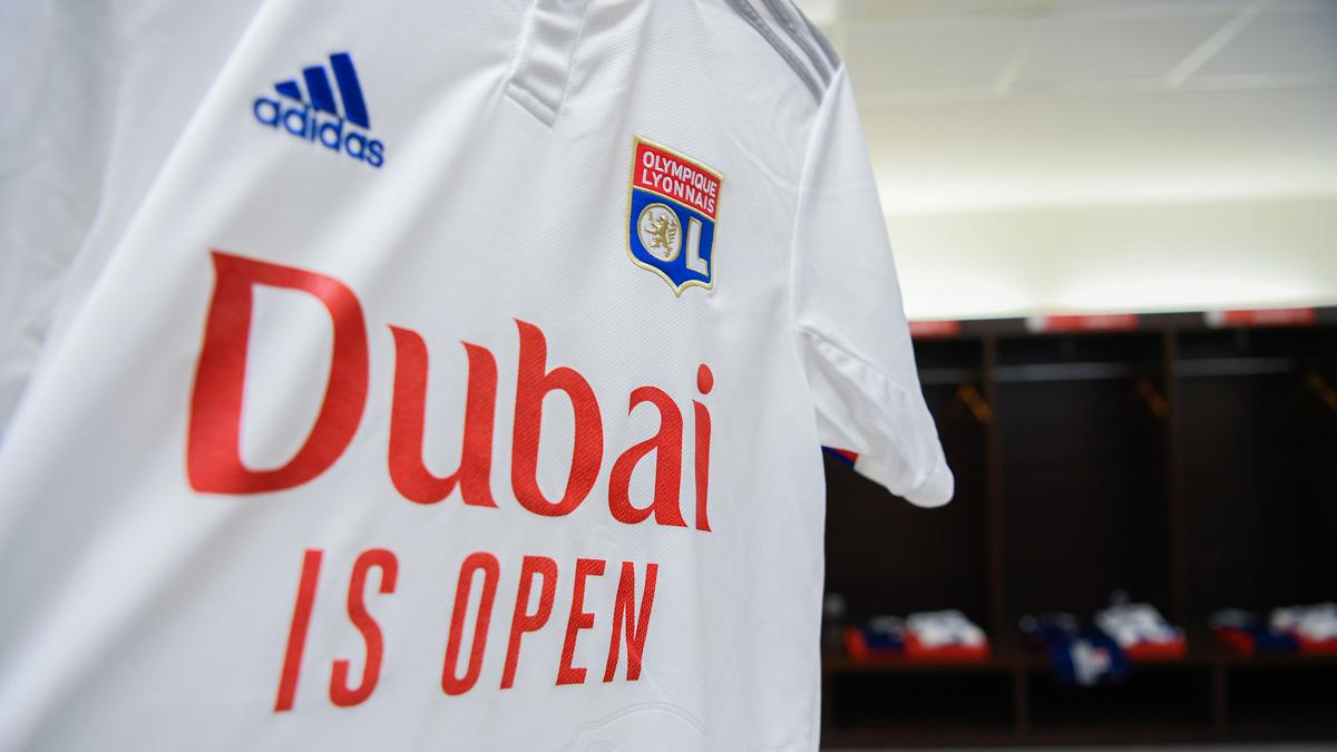 """Emirates and Olympique Lyonnais team up to tell the world that """"Dubai is Open."""" Congrats @OL on your debut win as an Emirates partner. We look forward to welcoming the world to Dubai from 7 July.   #FlyEmiratesFlyBetter https://t.co/bibsIssyGy"""
