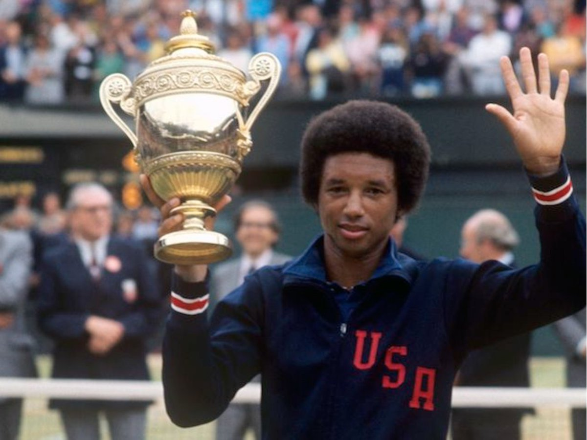 """#ArthurAshe grew up in Richmond, VA, as a skinny kid whose father said """"NO"""" to football. But """"Bones"""" took easily to tennis & began practicing with a racket at age 7. His dedication to the sport resulted in the first Wimbledon men's singles win by an African American, OTD in 1975. pic.twitter.com/YVXMj8rT5c"""