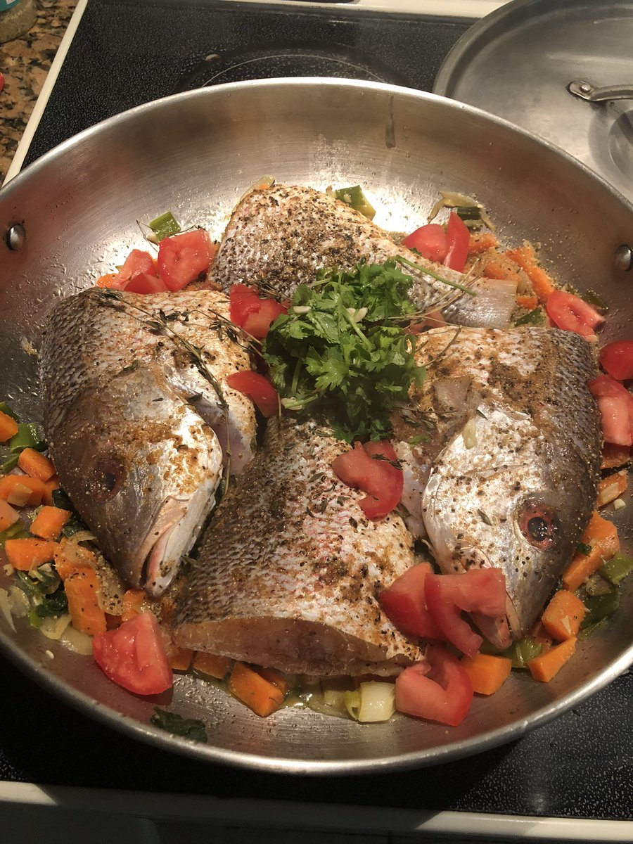 On a lighter note, I'm doing Sunday #Jamaica homesick cooking. The menu - steamed red snapper with veggies and a summer cucumber salad. Having it with Roti keeping the Trini flare going.  pic.twitter.com/8VLNjinAP1