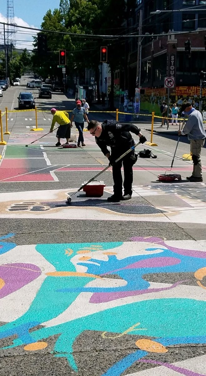 Its official, the Black Lives Matter street mural will remain on Capitol Hill in #Seattle. Community members, local artists, and police officers worked together over the weekend to seal it up along Pine St for preservation. (pic via @SeattlePD) #BlackLivesMatter #BLM #CHOP