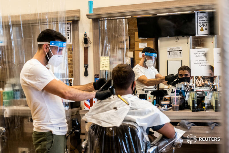 A customer gets his hair cut at a barbershop after its reopening in New York City. More photos of the day: https://t.co/C9FSKcmhkA 📷 Jeenah Moon https://t.co/27q0sQpyoZ
