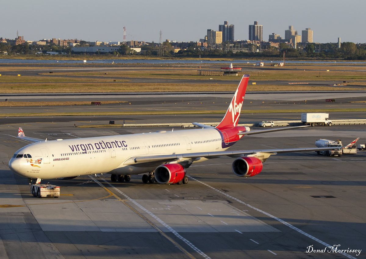 Pushing back @JFKairport to @HeathrowAirport on a sunny evening @VirginAtlantic A340-642 G-VFIT. (Sept 2019) #Avgeek #Aviation #VirginAtlantic #Airbus #Airtravel #Airlines #Planespotting #JFKAirport #TWAHotel #Throwback #Sunset #goldenhour https://t.co/y1SdD8msEx