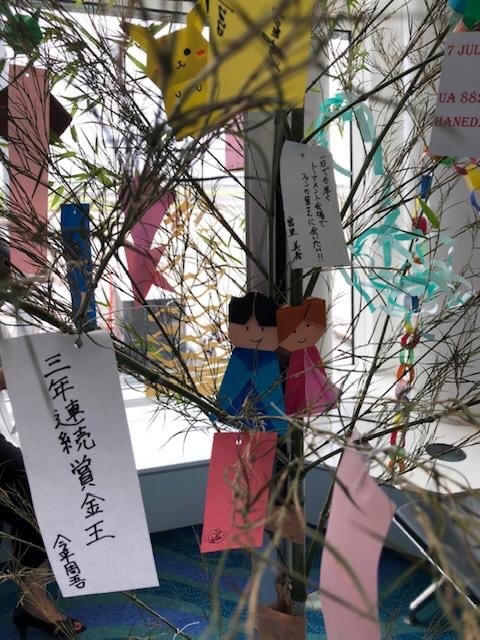 """HND - We are back in the air!!!Successful launch for HND-ORD flight. Happy customers , employees with Japanese wish tree as July 7th the day of """"Tanabata""""@weareunited @sam_shinohara @DJKinzelman #beingunited"""