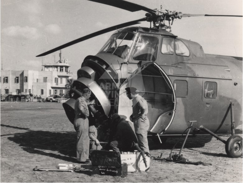 Mr J Coombs and Flight Sergeant Nelson work on a Whirlwind at El Gamil airfield during Operation MUSKETEER, 1956. The aircraft suffered serious corrosion caused by exposure to salt, sand and gale-force winds and within two weeks of arriving in Egypt, all Whirlwinds were grounded. pic.twitter.com/jcBaegystb
