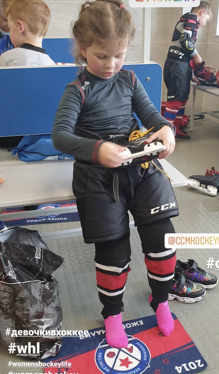 Rocking her pink socks and matching skate guards in a room full of boys at Fetisov's hockey school. Get it girl! 👏