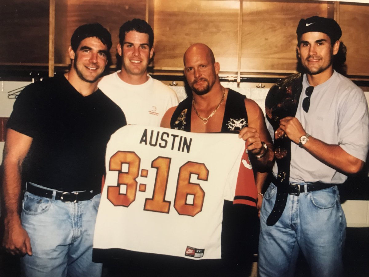 .@nhlflyers PR whiz Zack Hill was dusting off some old photos.  L to R:   John LeClair, Chris Therien, Stone Cold Austin and Dan Kordic (holding Austin's championship belt).   Austin was inducted into the WWE Hall of Fame in 2009. Photo:  Len Redkoles https://t.co/d8pn9zutYL