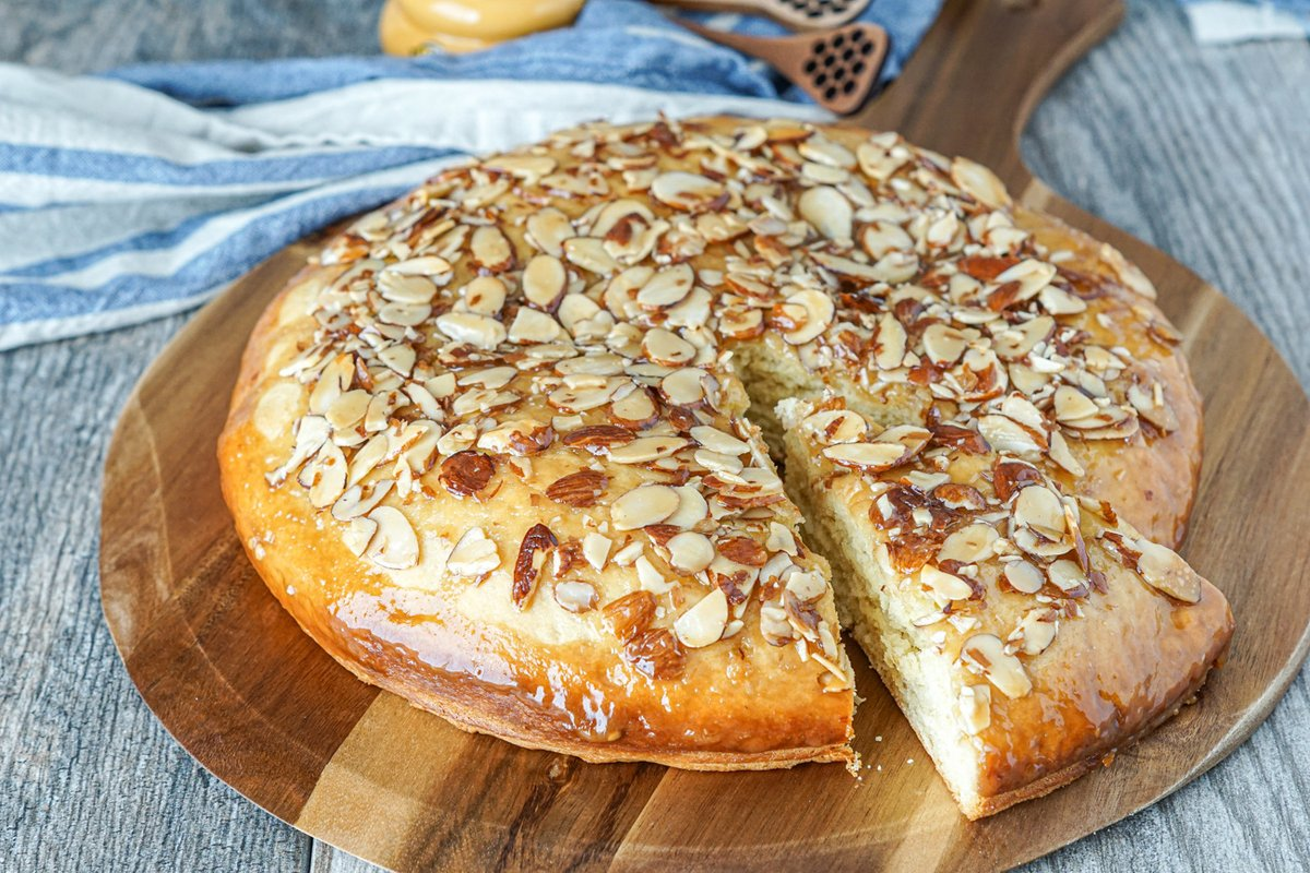 A recipe for a Honey Almond Coffee Cake! A cross between bread and cake, this yeast-based coffee cake is topped with a sweet and buttery honey almond glaze. Find the #recipe here: tarasmulticulturaltable.com/honey-almond-c… #coffeecake #cake #honey