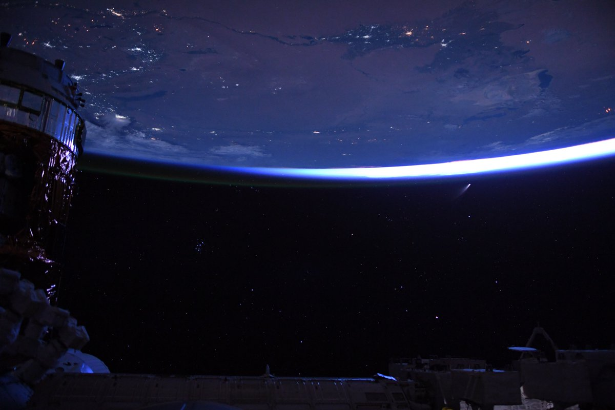 Night sky, just before dawn from @Space_Station. Stars, cities, spaceships, and a comet!