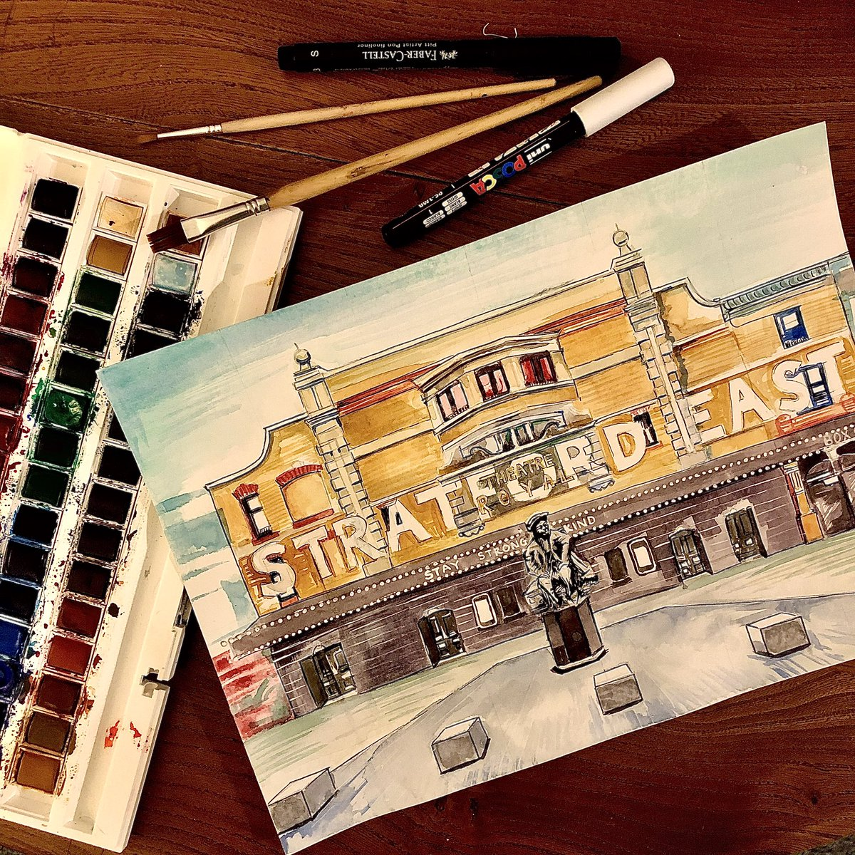 Painting of @stratfordeast I did today. Watercolour and fineliner. Part of a new series i'm producing of my favourite theatres. Miss this place. Hope everyone there is doing okay. pic.twitter.com/2nvQo1Hvz8