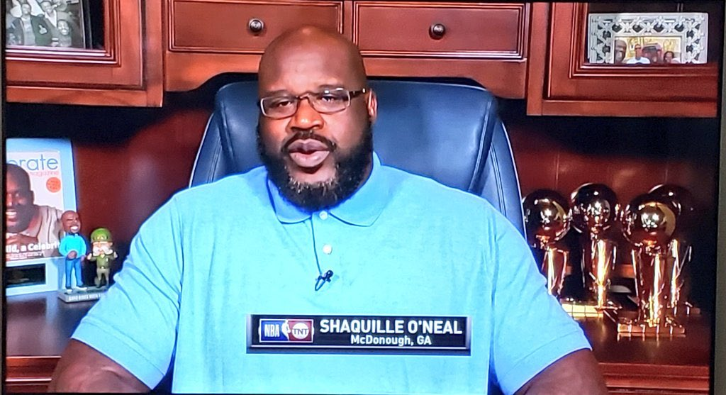 Nice cabinetry. Love the casual trophy display. Who is little green guy? 9/10 @SHAQ