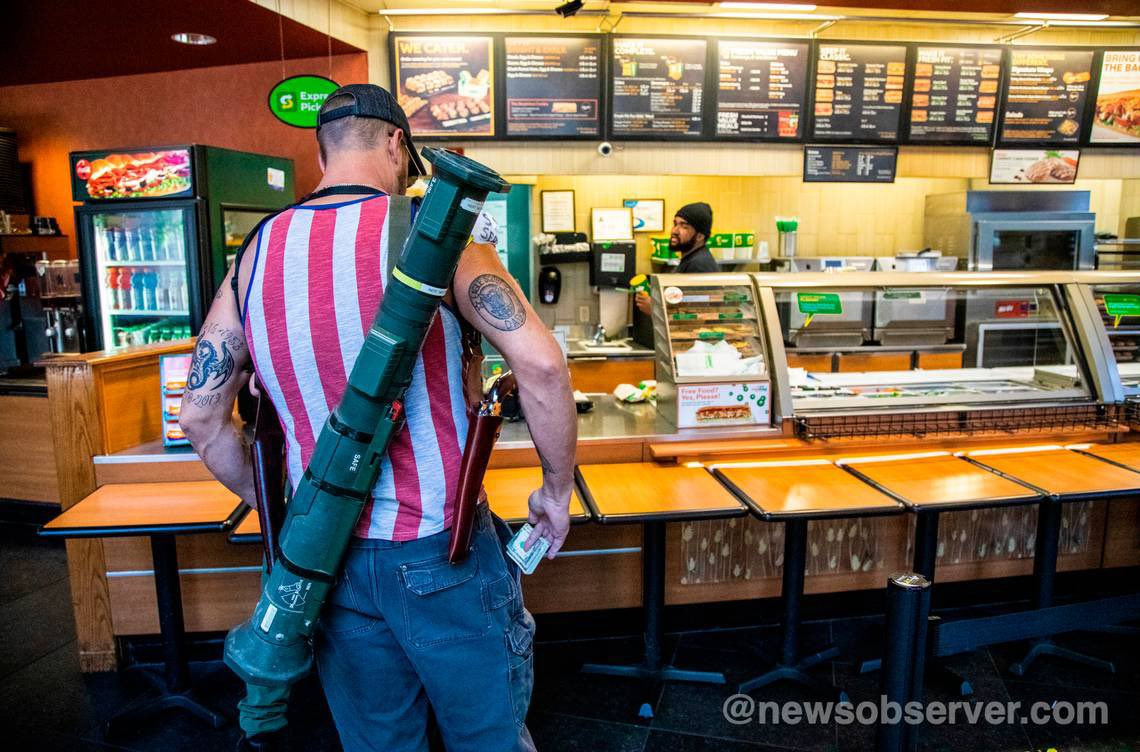"""@drinkkoolaidpod @MrHorror Based on a true story? Man with a bazooka at a Subway dares protestors to """"light this flag in fire."""""""