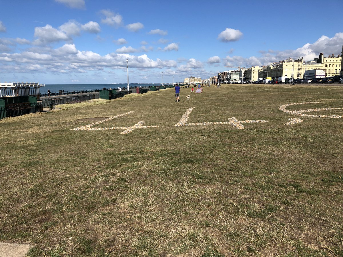 """Someone left this on #Hove Lawns. 44,602 numbered pebbles. One for each of the """"official"""" UK covid deaths, presumably. Don't know who did it."""