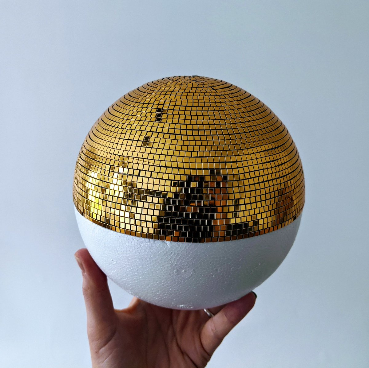 My golden disco ball is half finished. I seriously underestimated how much work this was going to be... https://t.co/jBHjlAijDM