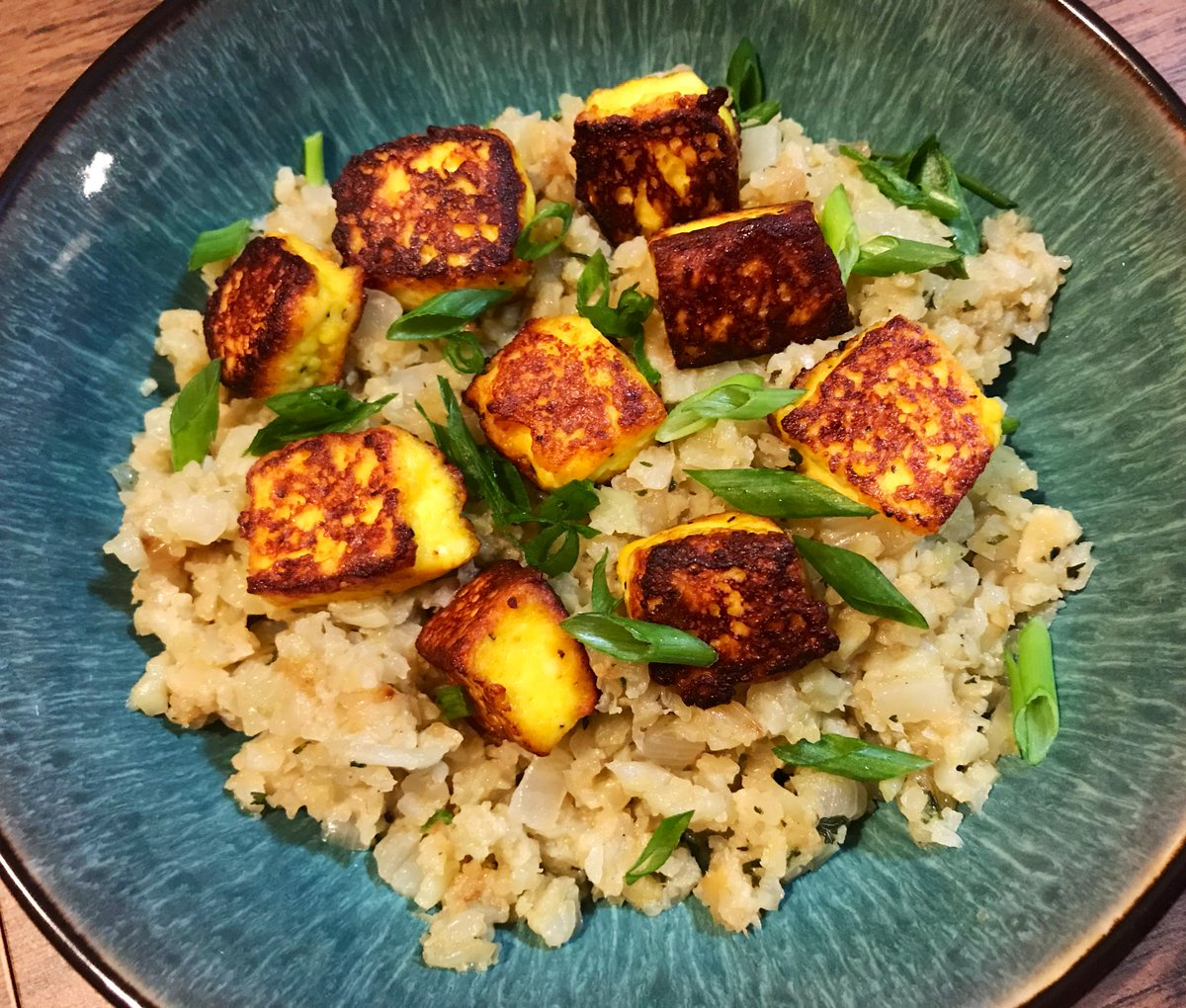 Turmeric Paneer fried in ghee over riced cauliflower sautéed in ghee with onion, garlic, & ginger Summer time food