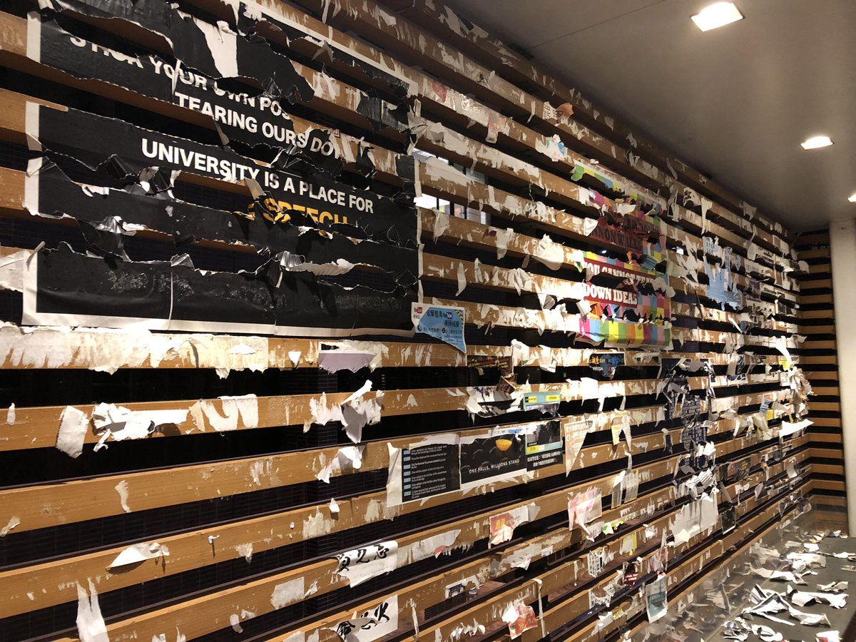 #LennonWalls on the University Street of #HKU were teared off at 7pm. Paper tearers left the scene when #HKUSU Exco arrived. Security guards of the @HKUniversity failed to stop them. #HKUSU vows to reconstruct the walls to safeguard #FreedomOfSpeech. https://t.co/uVWjCawZxb