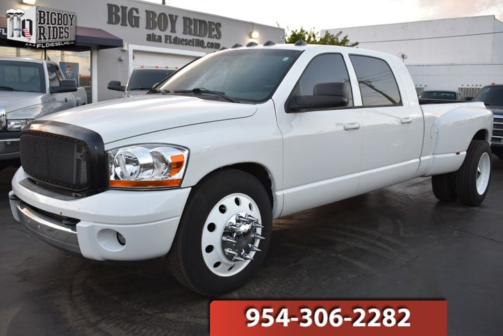 2006 Dodge Ram 3500 MegaCab - $17,995. Exterior: Bright White, Interior: Khaki Leather, Engine: 5.9L HO I6 Cummins Turbo Diesel, Transmission: Automatic, Drive Train: RWD, Mileage: 265,418. #Dodge #Ram features: https://bit.ly/2Jav39q pic.twitter.com/qHS6G1curE