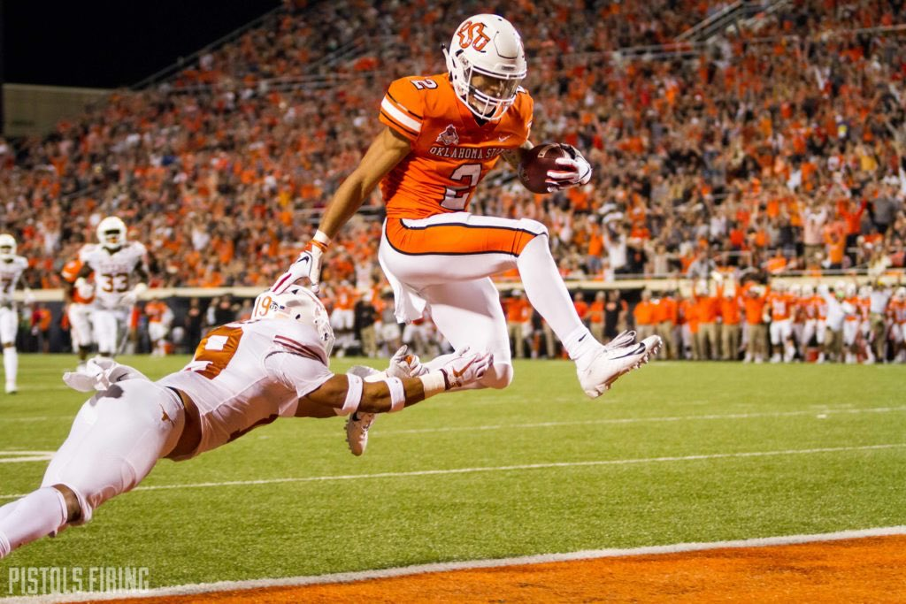 Nobody in college football plays bigger than his measurables than @CowboyFB WR Tylan Wallace. Consistently plays big on the ball and tacklers routinely glance off him. Listed at 6-0, 185 lbs but plays like he's 6-3, 215 lbs. Unique functional strength. 💪#TheDraftStartsInMOBILE https://t.co/XHnwvg8l8A