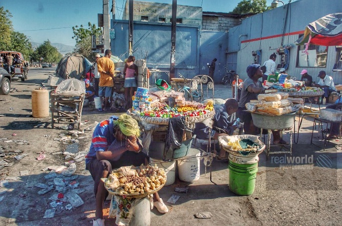 A vendor hides his face at a market in Port-au-Prince, Haiti. #photojournalism #world #Haiti #market #realworldphotographs #garymoorephotography #poverty #history #archive #history #travel #photography #images #Nikon #people #environment #places #editorial #Sweden #Malmo #HAI https://t.co/rxS7suUYQ8