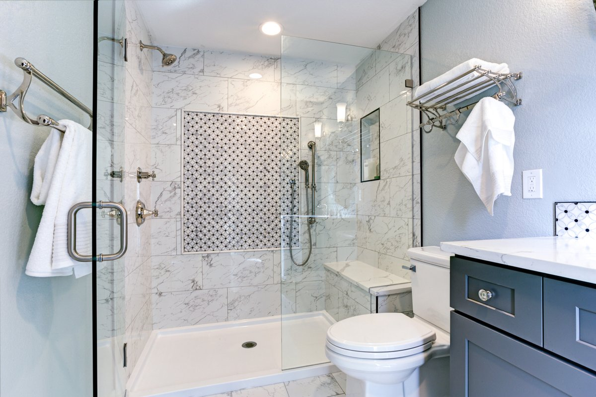 Vesta Marble Granite On Twitter Happy Sunday Porcelain Tile Shower Enclosure With Matte Silver Finishes Shower Bench Dark Vanity With A Quartz Surface This Bathroom Layout Is Striking And Classic Ottawabathroomreno