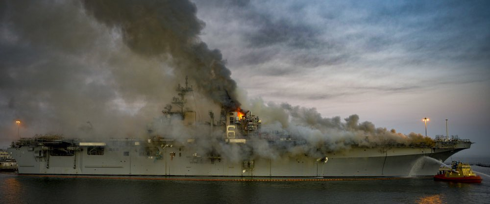 Last night, fire spread to superstructure aboard amphibious assault ship USS Bonhomme Richard in San Diego, massive warship is larger than some WWII-era aircraft carriers
