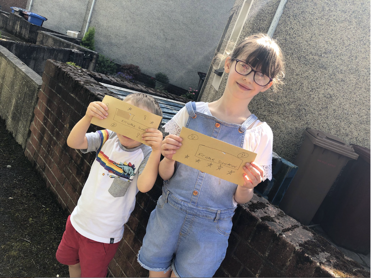 """Our team was very pleased this weekend to deliver donations to 2 youngsters who feature in our book #TigersAndTeddies, who completed @thekiltwalk in aid of @kanzenkarate. """"10 Kilometres, 6 miles!"""" is being delightedly shouted out as the envelope is showed proudly to the camera!"""