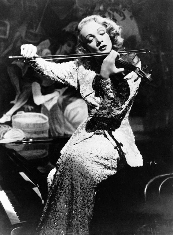 marlene dietrich playing music instruments, 1940s  miss dietrich's passion for music came in her early years in 1920s she studied the violin in weimar, years later she learned to play the musical saw, an instrument she used several times to entertain the troops during ww2 pic.twitter.com/ObqAkQ5MHQ