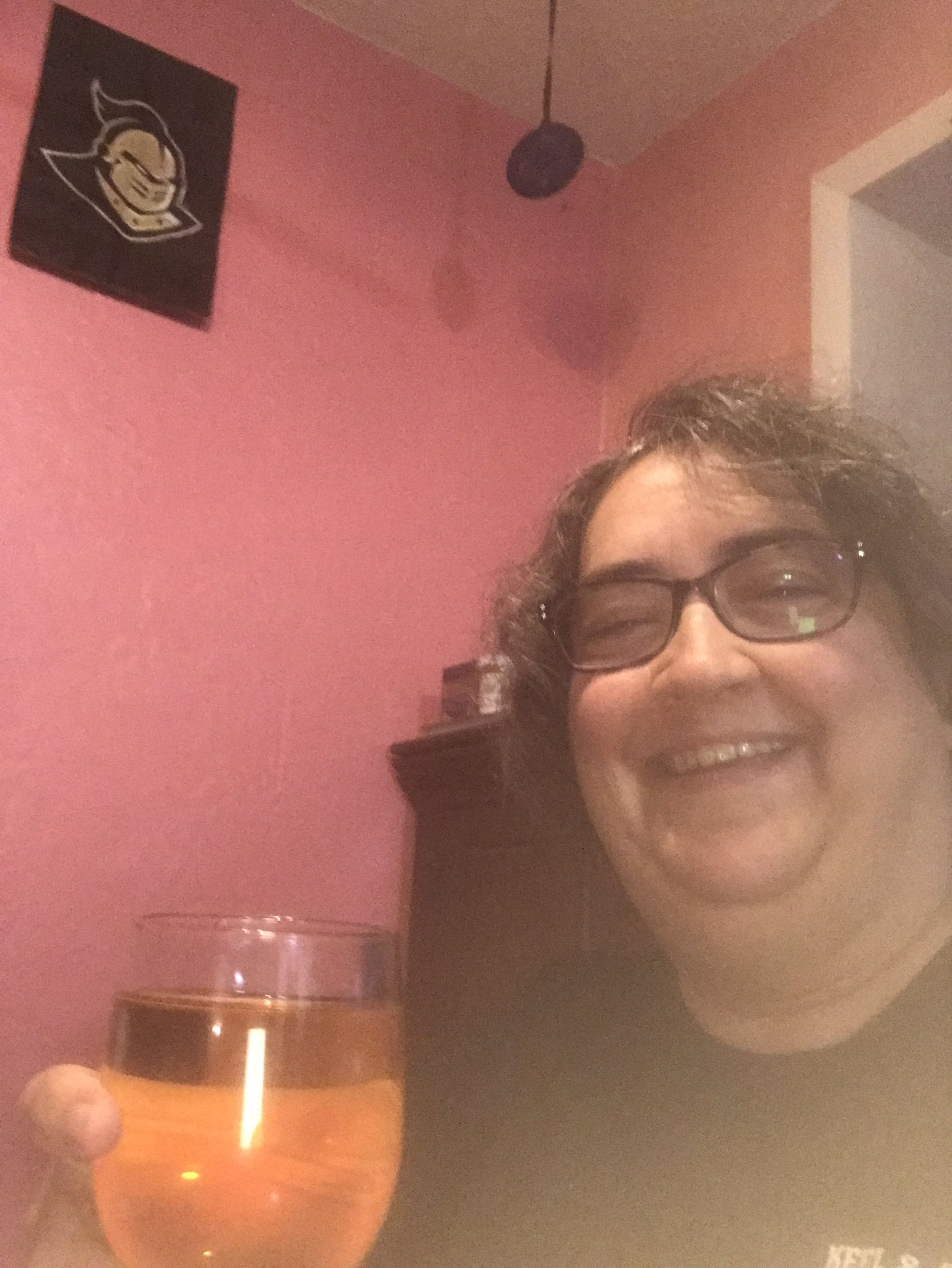 Lara Zielinsky toasting her acceptance to grad school with wine