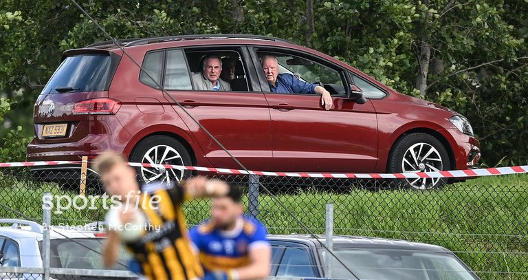 Supporters watch on from their car outside the ground during the Armagh County Senior Football League Group A Round 1 match between Maghery Sean McDermotts and Crossmaglen Rangers at Felix Hamill Park in Maghery.  📸 @Sportsfilesteve   https://t.co/LMsUTfvrUB https://t.co/rJKz4r0wN4