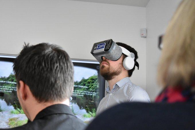 Man in an office wearing a VR headset.