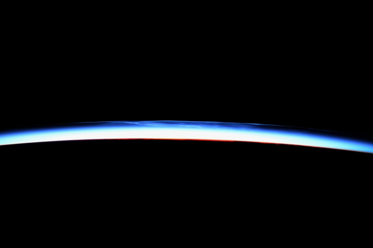 Noctilucent or 'night-shining' clouds highlight Earth's upper atmosphere at twilight.