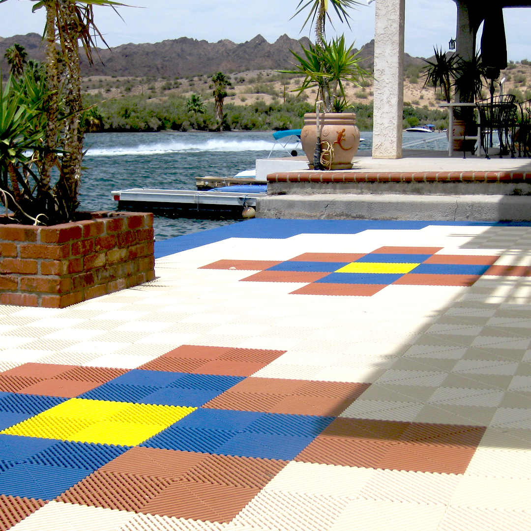 Layout out the land at the lake! Nothing like beating the heat on this patio. Who wants to jump in? It's the Weekend!  . . . #Swisstrax #ModularFloor #GarageGoals #GarageTransformation #Ribtrax #Ivory #TerraCotta #IslandBlue #CitrusYellow https://t.co/bkyRdHquU9