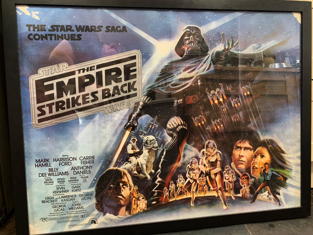 Lockdown #zoom backdrop #filmposter today is my UK quad for THE EMPIRE STRIKES BACK, 1980.   This is the rare first edition with the black title text on silver.  Artwork by Tom Jung.  Still the greatest #StarWars movie!pic.twitter.com/b4QVXOLOd7