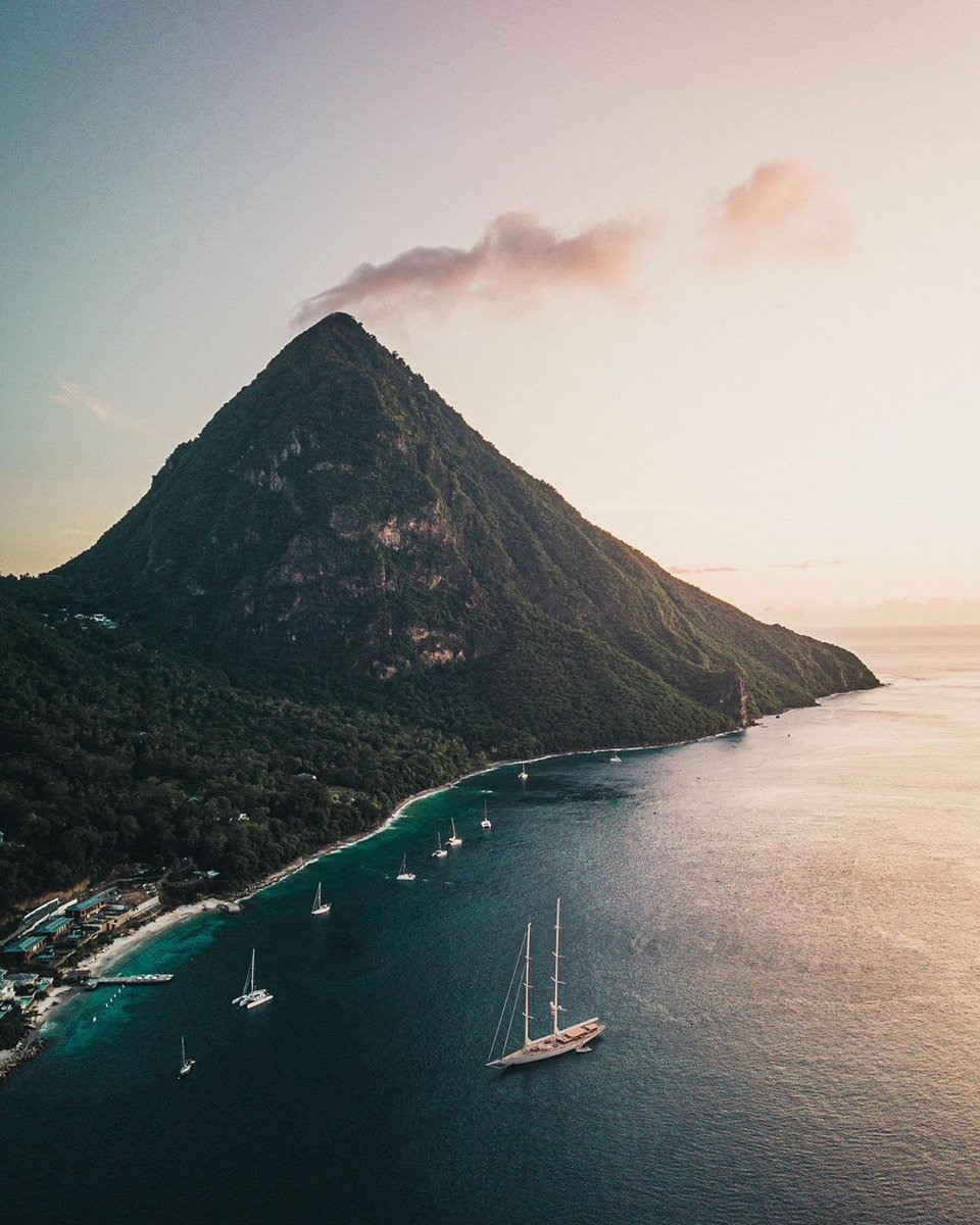 👣🌴 Saint Lucia is an Eastern Caribbean island that is home to the majestic Piton Mountains ⛰️, volcanic mud baths 🌋, sun-soaked beaches 🌞 and vibrant culture 🎉.   👉 https://t.co/ZNTJd2YQVT  https://t.co/NK8aJYIuMN