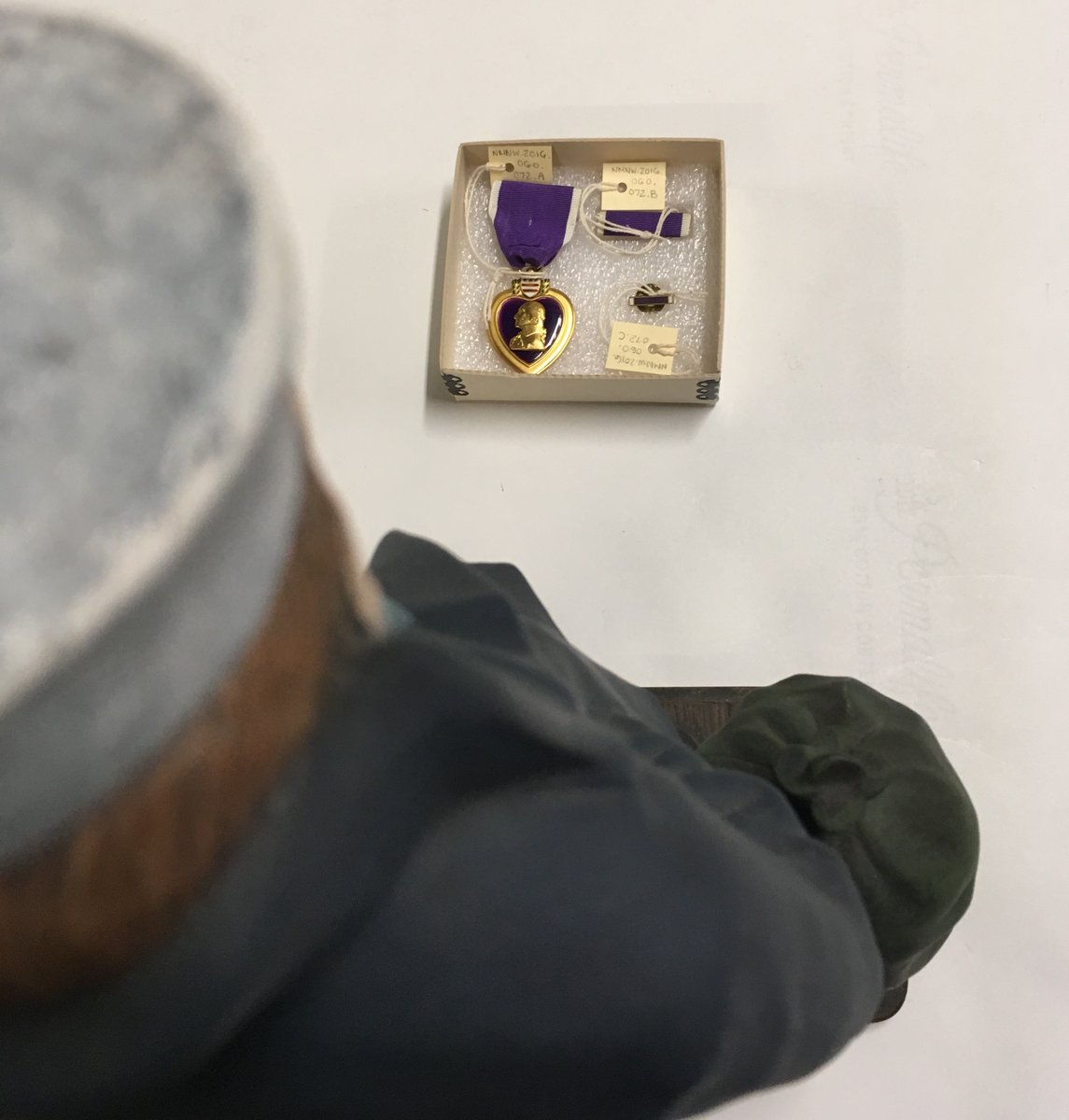 In honor of Purple Heart Day, Lone Sailor is taking a break from his usual silliness to admire a Purple Heart medal in our collection.  Learn more about the life of the #WWII sailor who earned this medal: https://www.facebook.com/watch/?v=632634100790502…   #PurpleHeartDay #BeLikeTheLoneSailorpic.twitter.com/59khewbZvR