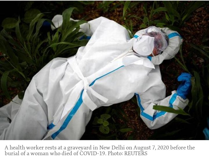 A Health Worker Rests at a graveyard in New Delhi on 7th August,2020 before the burial of woman who died of #covid19 #pendemicovid19 #SaluteCoronaFighters #SaluteOurHeroes https://t.co/lBXQJMeedK