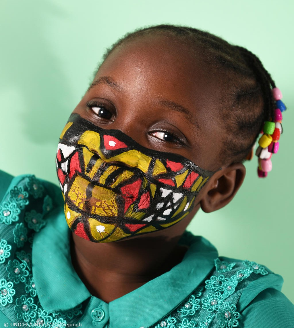 """""""It's important to be happy during this corona period. My dream is to become a pediatrician."""" Nora, 9, with a painted mask in Abidjan, Côte d'Ivoire, where children painted their face to raise awareness about the importance of wearing a mask during the pandemic. #WorldMaskWeek"""