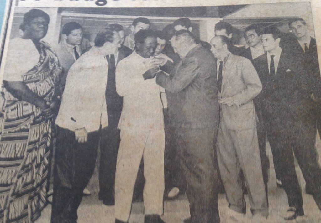 Real Madrid president Santiago Bernabeu pinning his club's badge on the chest of Kwame Nkrumah (middle, all white) after the Spanish giants visited Ghana and were held by the Black Stars to a 3-3 draw in 1962. Ohene Djan (1st from left) looks on.