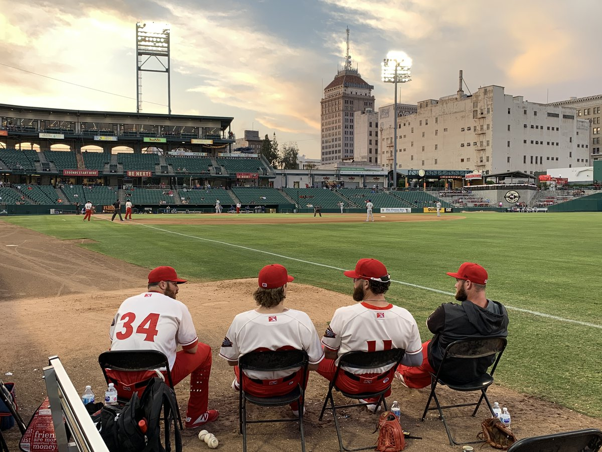 NEW THIS WEEK: This is one of my favorite shots from our 2019 California Baseball Road Trip. The @FresnoGrizzlies bullpen, the guys wearing those sweet red-and-white jerseys, with a fine view of a lively baseball sky. Story, photos, and video from Day 7 at mappingthepath.com/day-7-fresno-g…