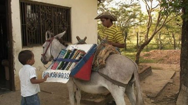 Biblioburro, the #traveling #library- Using two donkeys, Alfa and Beto, Luis Soriano travels up to 4 hours to share #books with the children residing in the remote villages of #Columbia. #Reading #writing #animals