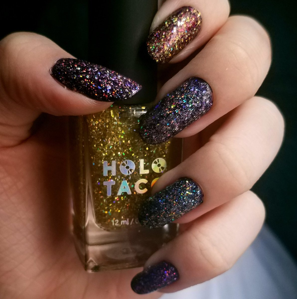 The anniversary collection finally came  added it on top of the holoday glitter collection. Its stunning in the sunlight  @holotaco @nailogical #nails #nailpolish #holotacopic.twitter.com/9IBPuI88tN