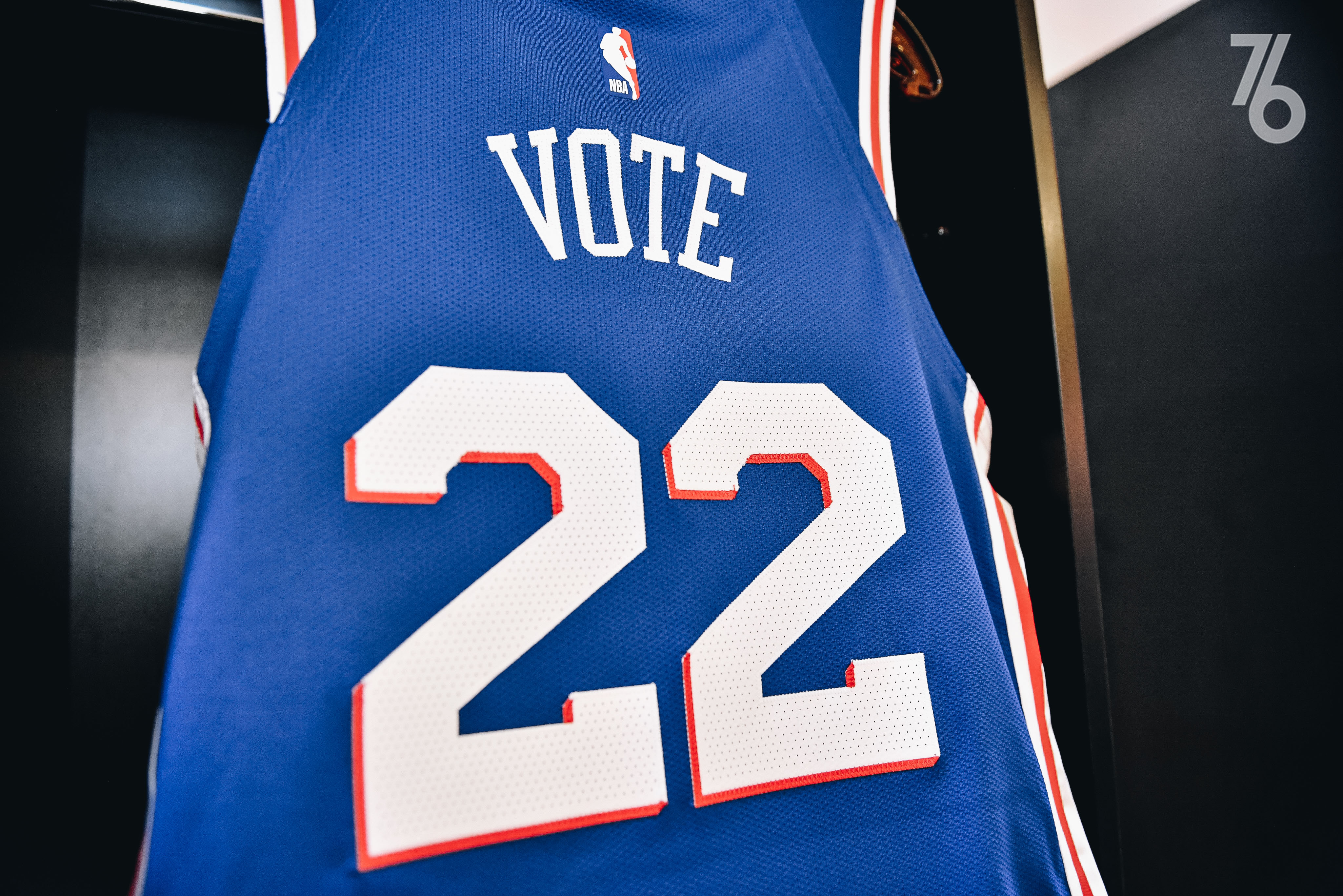 "back of basketball jersey that reads ""Vote."""