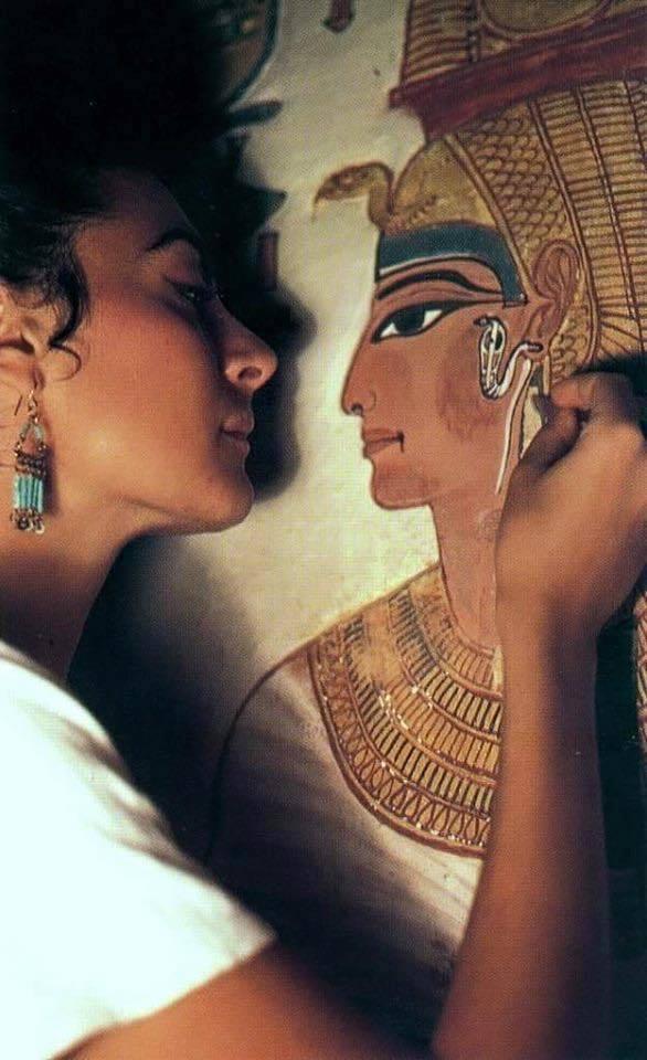 Italian conservator Lorenza D'Alessandro restoring a mural of the Egyptian Queen Nefertari.
