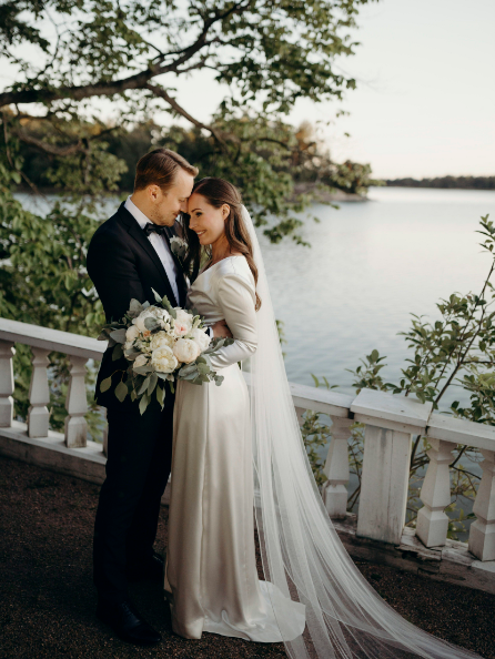 Finland PM posts her wedding pictures on social media; Sanna Marin has married her long-time partner 8 months after becoming head of government: (Finnish Prime Ministers Office/AP)