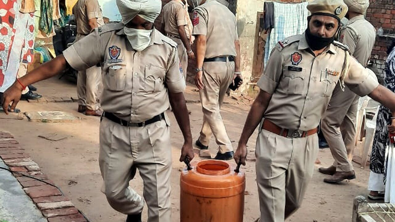 tainted-alcohol-in-india-kills-dozens-spurring-authorities-to-conduct-over-100-raids Photo