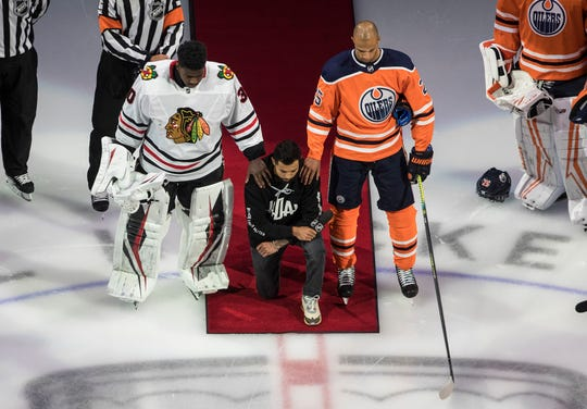 """Did anyone else think it was odd at Saturday's pre-game ceremony talking about the need to end racism, especially silent, systemic racism, and one of the three guys at centre ice is wearing a cartoon of an """"Indian head"""" on his shirt?"""