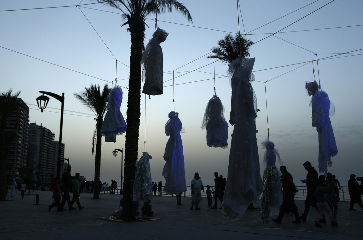 Women hang wedding dresses, Beirut seafront, to protest law allowing rapists to escape punishment if they marry their victim, 2017 #womensart