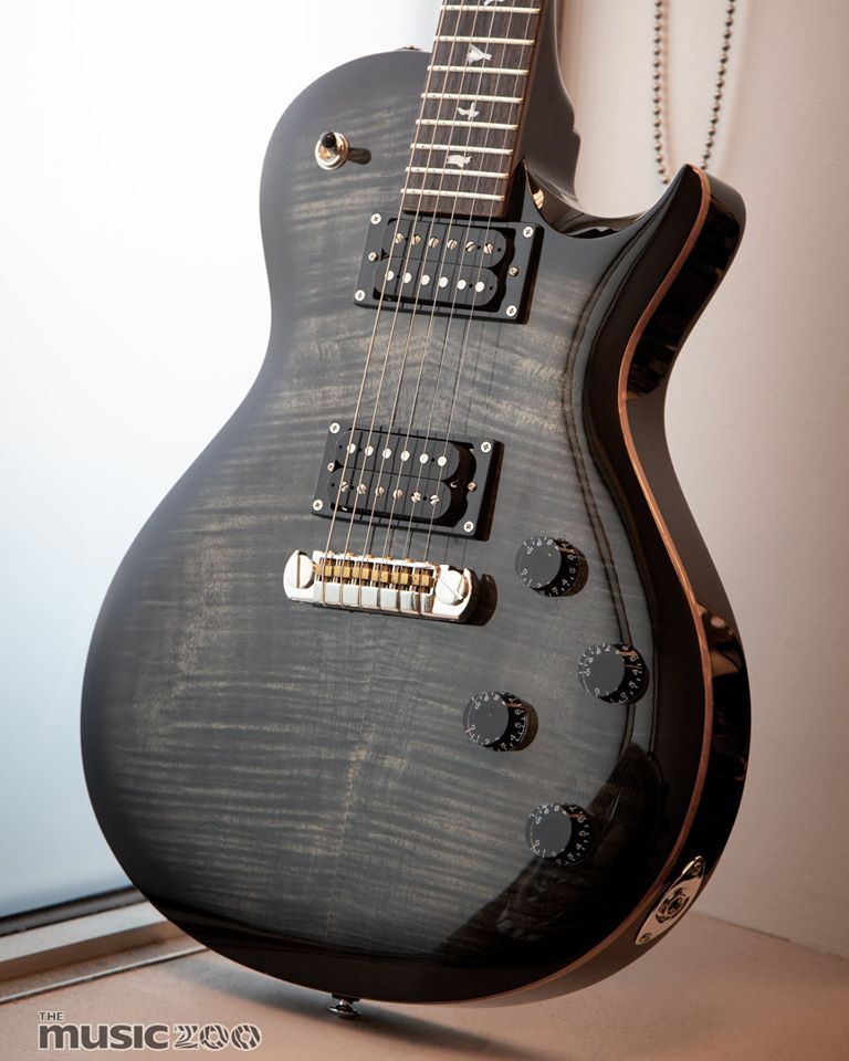 """This @prsguitars SE 245 boasts a Charcoal Burst finish and is made for the player who can't get enough of that slightly short 24.5"""" scale! Ready to make this one yours?  Shop now: http://bit.ly/MZprscollection  #prs #guitarsdaily #guitarspic.twitter.com/f53DIgvXCq"""
