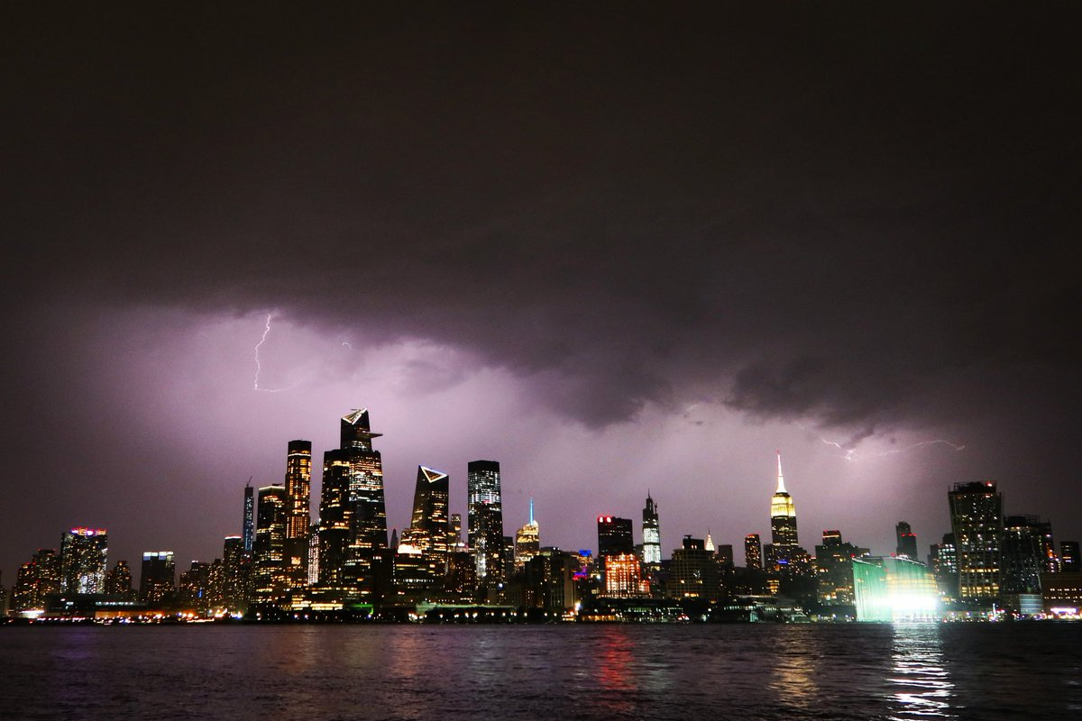 Lightning lights up the sky behind midtown Manhattan and the Empire State Building in New York City Monday evening ahead of the tomorrows arrival of Hurricane Isaias #newyorkcity #nyc #newyork @empirestatebldg #lightning #thunderstorm #HurricaneIsaias @agreatbigcity