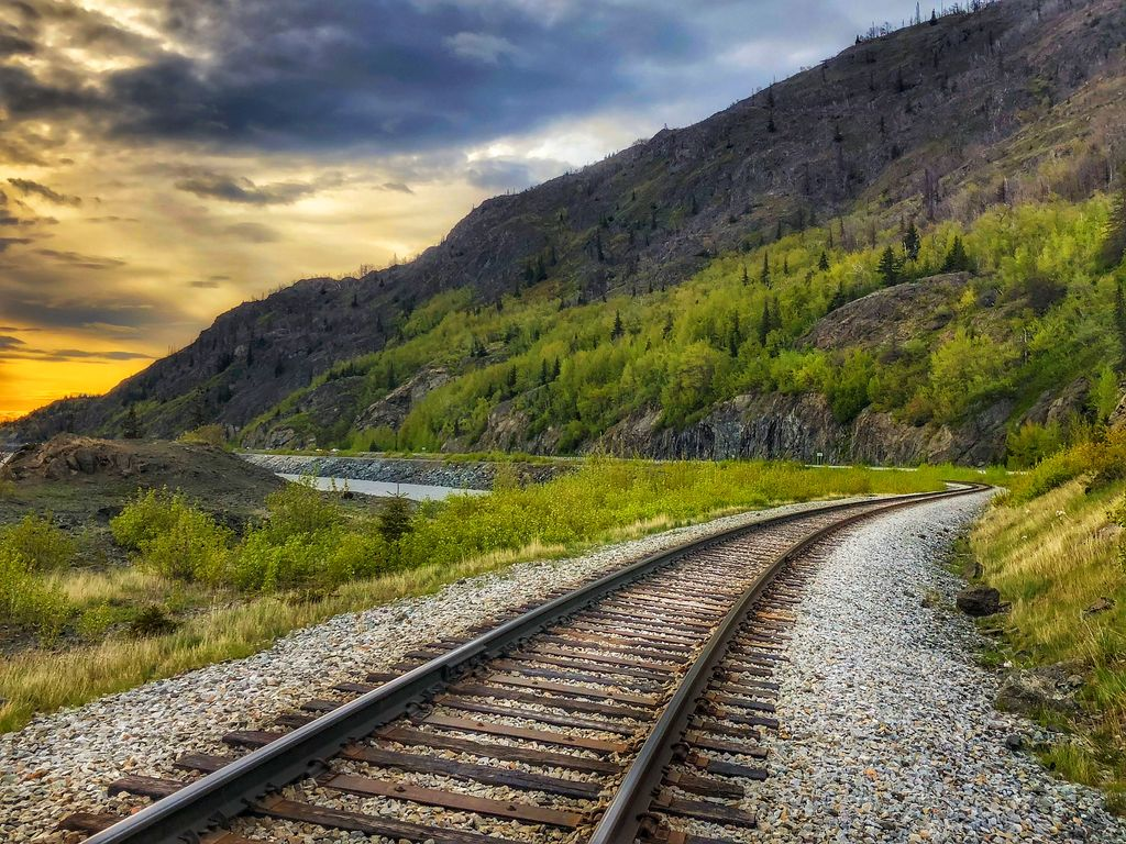 """""""Neither a wise man nor a brave man lies down on the tracks of history to wait for the train of the future to run over him."""" - Dwight D. Eisenhower  #nature #outdoors #scenery #traintracks #landscape #railway #travel #sky #horizon #railroads #trip #mountain #railroad #journeypic.twitter.com/QfRNs2p3Dz"""